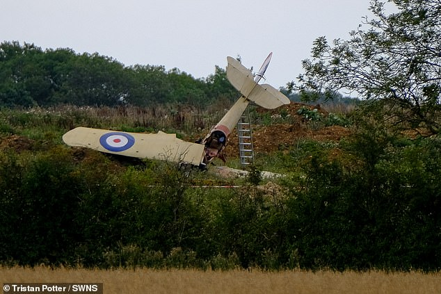 A pilot of Britain's first-ever military aeroplane survived a crash following a mock dogfight