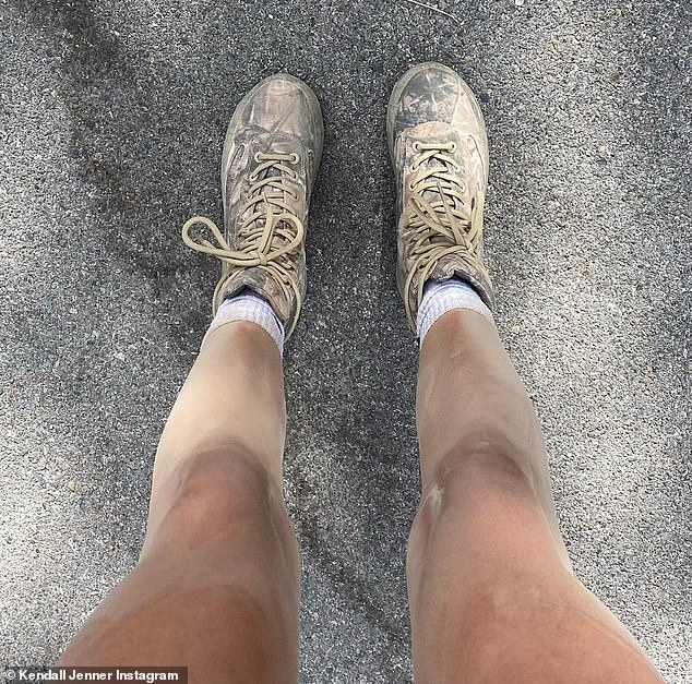 Roughing it:Kendall wasn't afraid to get a bit dirty, also sharing a first-person look at her dust covered legs and shoes