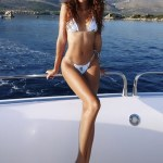 Joan Smalls shows off her enviable physique in a tiny white bikini during a yacht day in Croatia