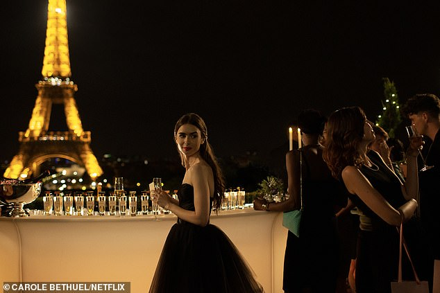 Emily in Paris, which airs 2nd October on Netflix has already drawn comparisons to Sex and the City, Gossip Girl, and the Devil Wears Prada thanks to the stunning looks sported by Lily in the trailer, which Netflix released this week. Emily (Lily Collins) is pictured at a party in front of the Eiffel Tower