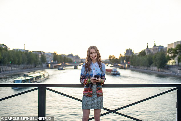 Emily (Lily Collins) is pictured in front of the Seine in a beautiful blue patterned skirt and snakeskin mini-skirt, one of her many jaw-dropping outfits in the show