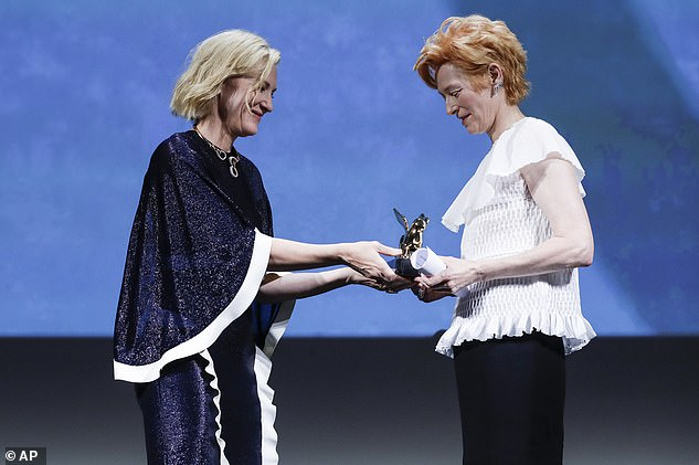 Delighted: Screen star Cate looked pleased as she handed the award to her fellow thespian