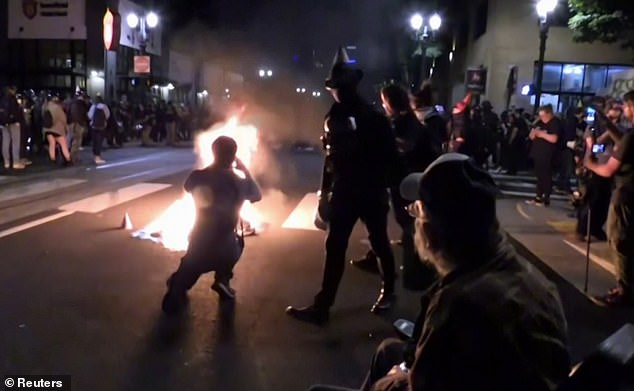 Protests are seen earlier this week in Portland, which has seen 99 nights of unrest