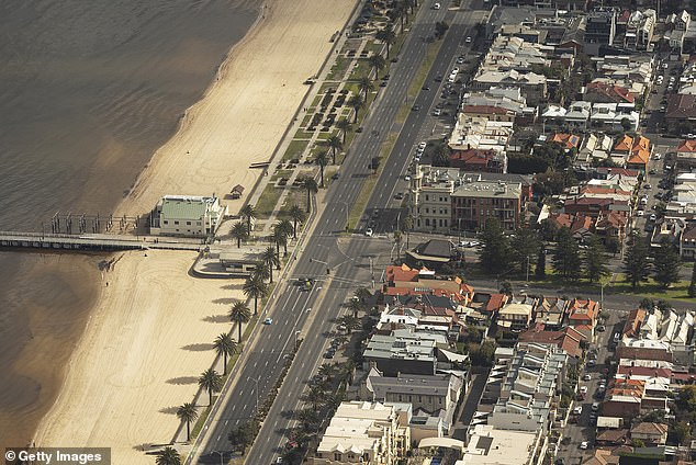 A deserted beach in Port Melbourne in August. It will continue to be empty as Melbourne heads into the warmer months