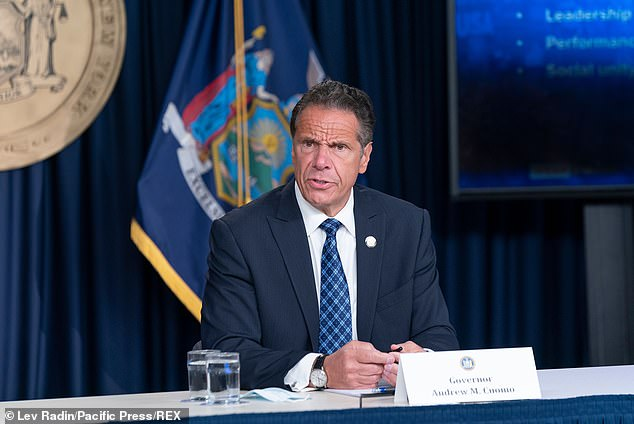 New York Governor Andrew Cuomo (above) has rebuked President Donald Trump over his threat to pull federal funding from 'lawless' U.S. cities
