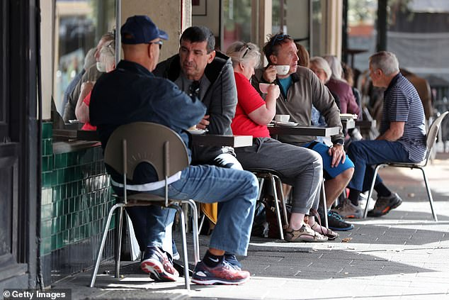 The study found thatcirrhosis could be inherited, especially from fathers (pictured, customers enjoy a coffee in Fremantle in May)