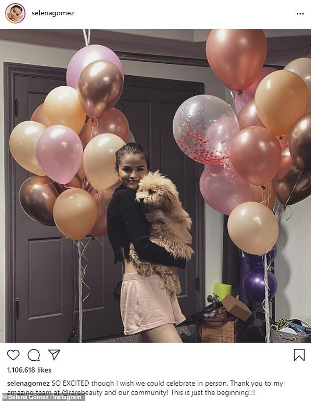 Happy: She officially launched her Rare Beauty makeup collection on Thursday. And Selena Gomez celebrated by sharing a photo posing with beloved pup Daisy surrounded by balloons