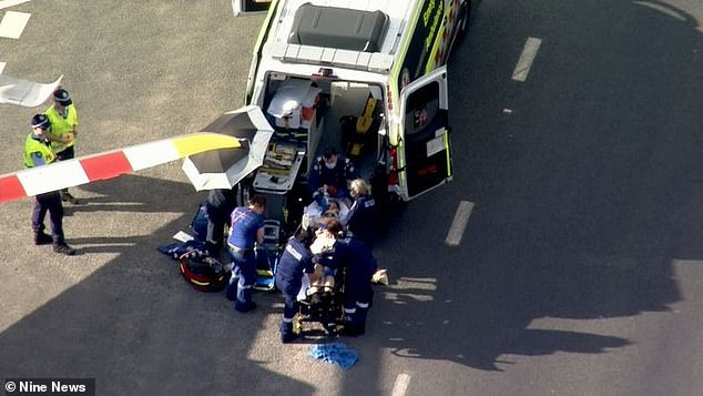 Three emergency crews (pictured) and a helicopter attended the scene and the boy was taken to Liverpool Hospital