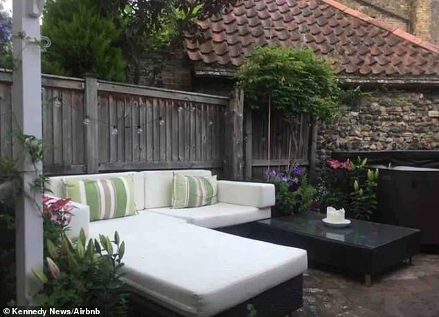 The seaside cottage in Kent has a seating area in the garden as well as a large hot tub for guests