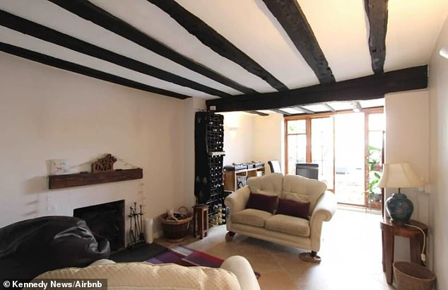 The Airbnb listing for the 15th-century cottage in Sandwich, Kent banned larger guests because they could cause 'serious damage' to the oak beams (pictured)