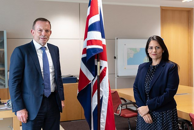 Home Secretary Priti Patel tweeted a photo of herself with Mr Abbott last night
