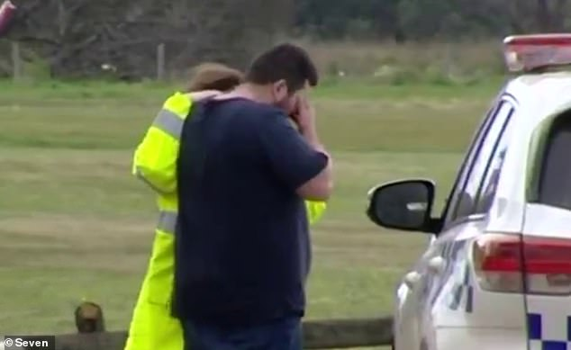 A two-year-old girl has drowned after going missing at The Esplanade in Portarlington, Victoria, before being pulled unresponsive from the water (a distraught man pictured at the scene)