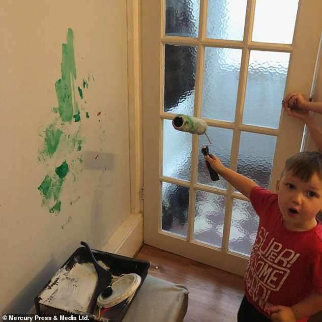 Romeo has been documented by his mother getting into all sorts of disasters at their home in Torquay, Devon. Here he is picturedgiving the freshly-painted grey living room wall a lick of green poster paint