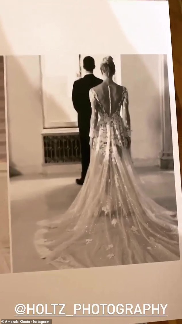 Lovebirds:She ended with a picture of herself coming up to Nick from behind, before tapping him so he could see her for the first time on their wedding day