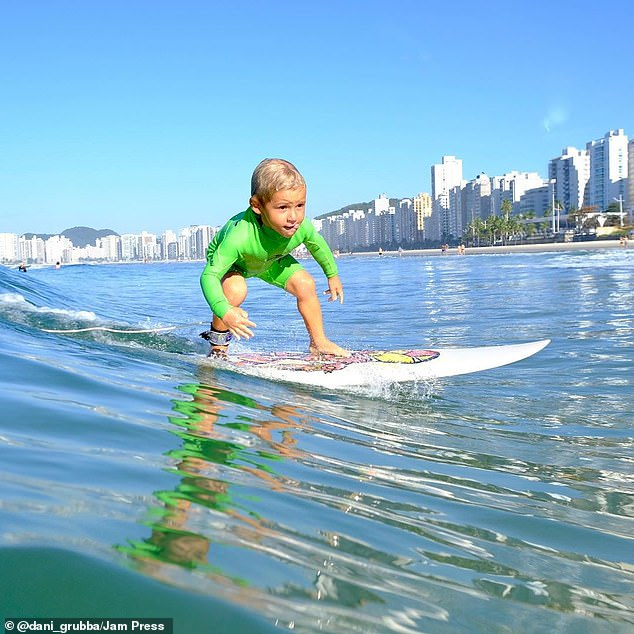 The young boy impressed and shocked his parents when he asked to surf and on the second wave he was able to stand up completely unassisted at the age of two