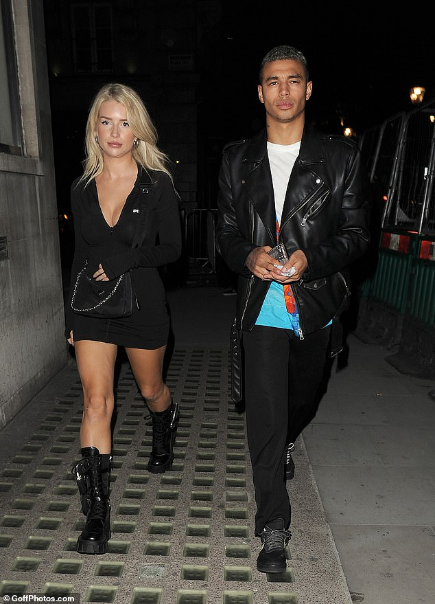 Pals:Lottie was joined by a hunky male friend for her London night out, who was equally well dressed in a leather jacket and colourful shirt
