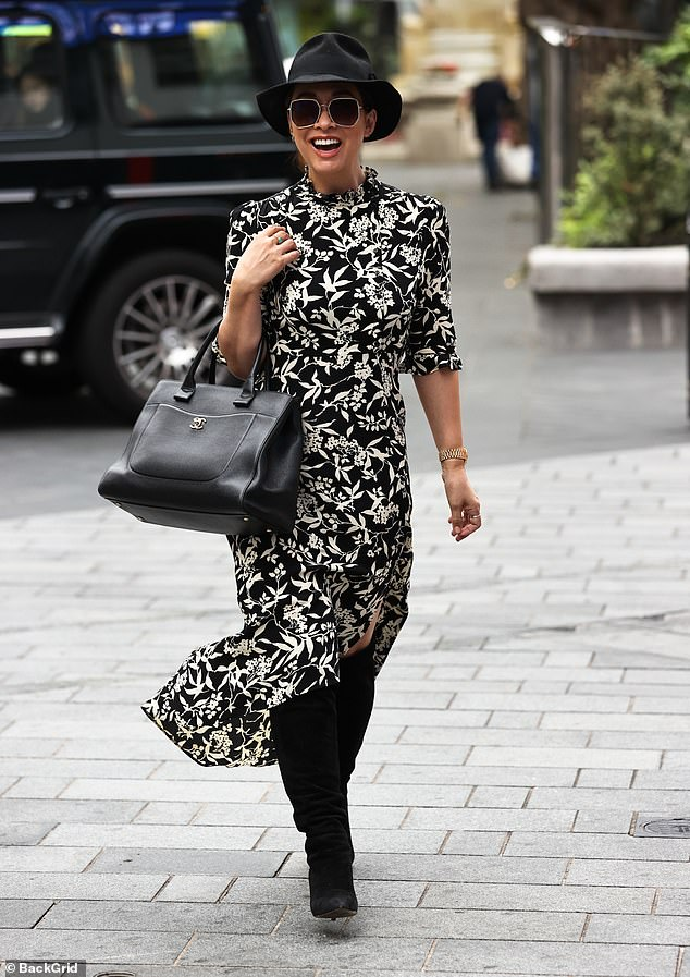 Outfit: The media personality showcased her sense of style as she donned a black midi dress with a white floral print