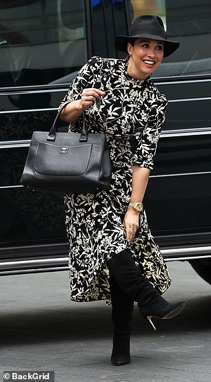 Wow: Looking in good spirits as she arrived to the studio, Myleene also sported a gold wristwatch