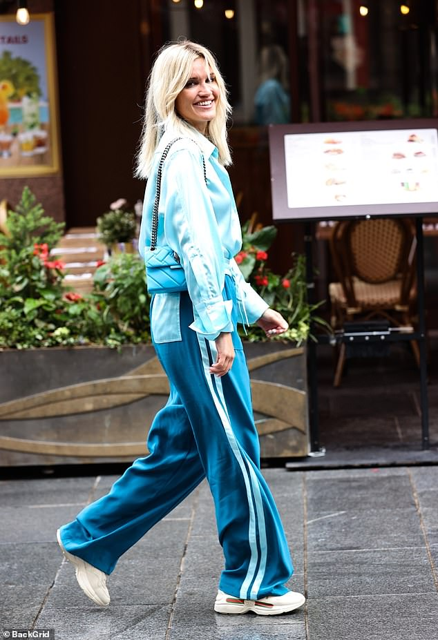 Fashionista: The radio presenter, 38, donned a chic blue silk shirt and jogging bottoms in a darker hue as she made her way home after hosting her breakfast show