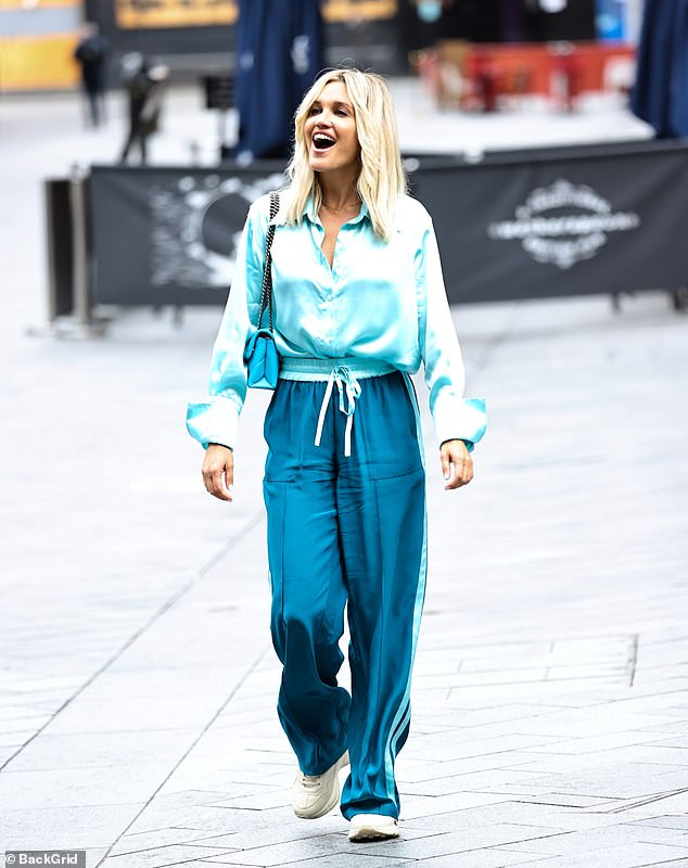 Street style: She finished her look with a pair of white Gucci trainers, while she carried her essentials in a blue Kurt Geiger handbag