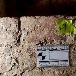Tradies find 180-year-old graffiti in a Tasmanian jail etched into the brickwork by soldiers