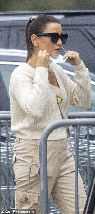Style: The star added a pair of chunky trainers in a similar hue, while she shielded her eyes with dark sunglasses