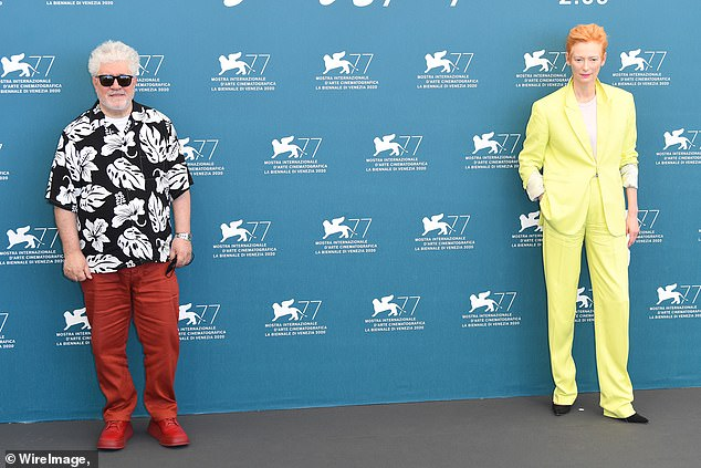 Colourful: The filmmaker matched Tilda's quirky vibe with bright red trousers and a print shirt