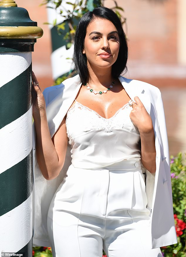 Glamour! The model, 26, was spotted outside the Hotel Excelsior Venice Lido Resort as she posed up a storm in her sophisticated ensemble