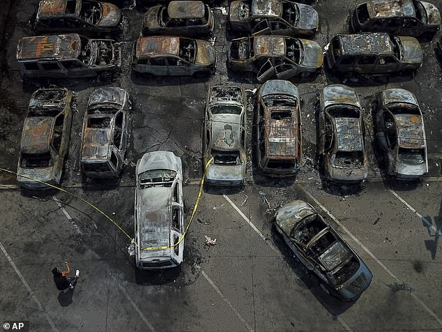Burned out vehicles are seen Monday, August 24, 2020, in Kenosha, Wisconsin. Many were set on fire during the protests