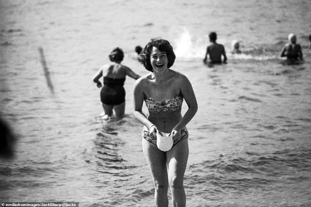 An unknown friend of photographer Jack Sharp getting ready for a dip with her swimming cap