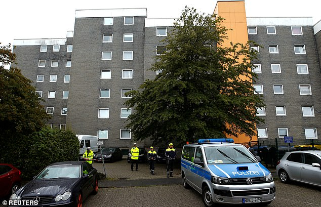 Emergency personnel outside the apartment block in Solingen where five children were found dead in Germany today