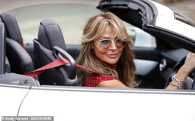 Oh dear: Lizzie had been cruising along in her new Mercedes convertible when she came a cropper