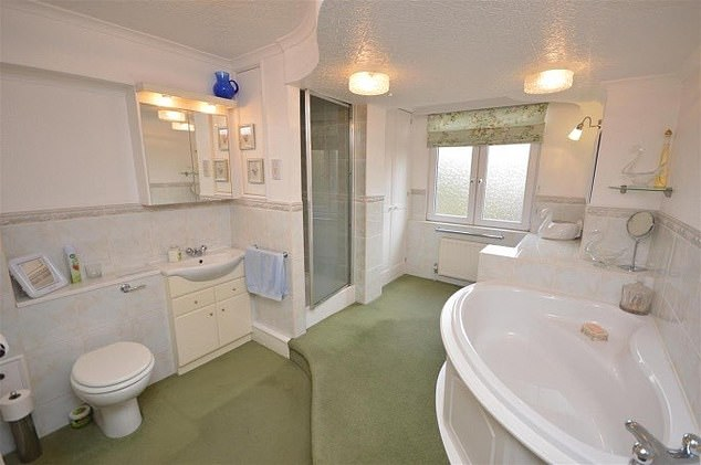 Before the bathroom looked dated, with avocado green carpets and old light fixtures