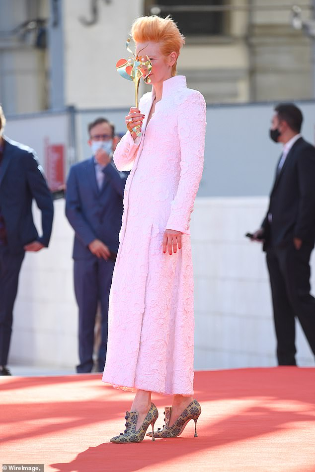 Outfit;The garment also featured a detailed embroidered floral print while Tilda added height to her frame with a pair of green heels