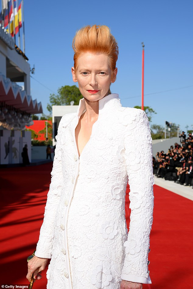 Fashion: The actress displayed her sense of style as she donned a white long-sleeved dress with a high collar