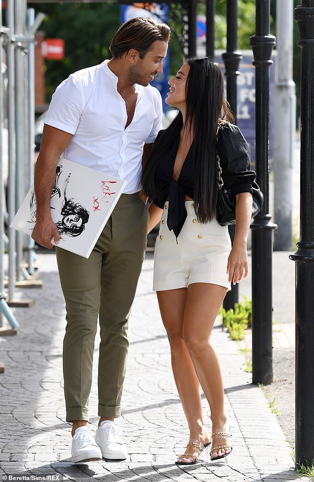 Happy again: The pair looked more loved up than ever as they filmed new TOWIE scenes last month