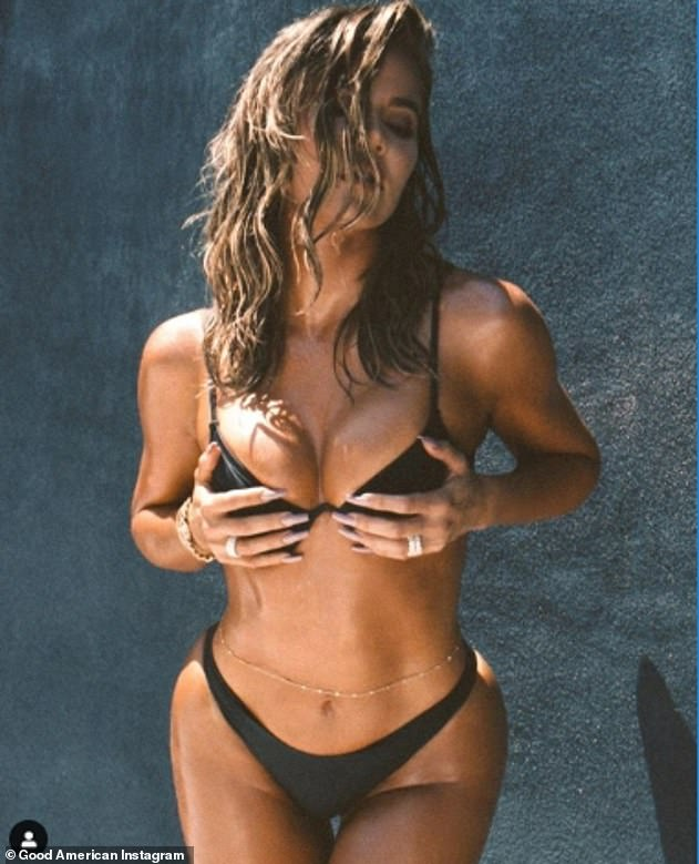 Incredible:Khloe sizzled in a skimpy black bikini from her Good American line in a set of new social media photos