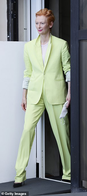 Suits you: Ahead of the film's premiere in the evening, the acclaimed actress posed for photos, looking chic in a bright yellow suit