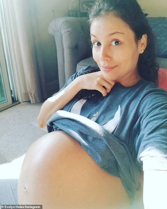 'Waiting for you baby boy!' Halas shared this baby bump snap in late August