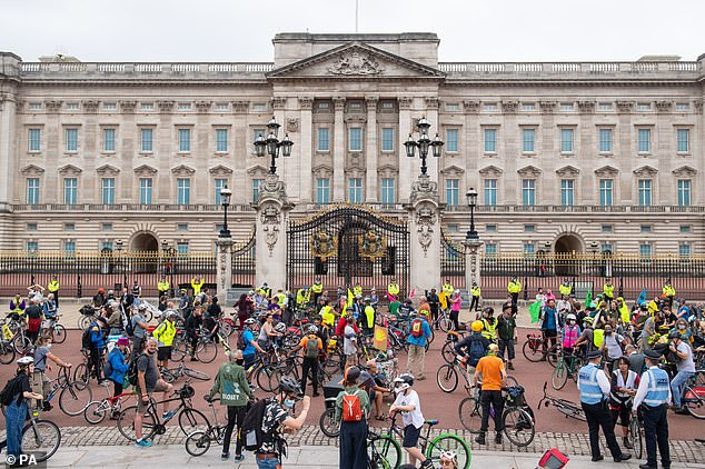 Cyclists gather outside Buckingham Palace during an Extinction Rebellion protest in London. The environmental campaign group has planned events to be held at several landmarks in the capital