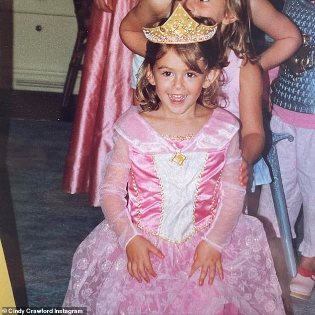 Too cute! Cindy shared an adorable photo of Kaia dressed in a pink princess down and a gold crown from when she looked to be around four or five years old