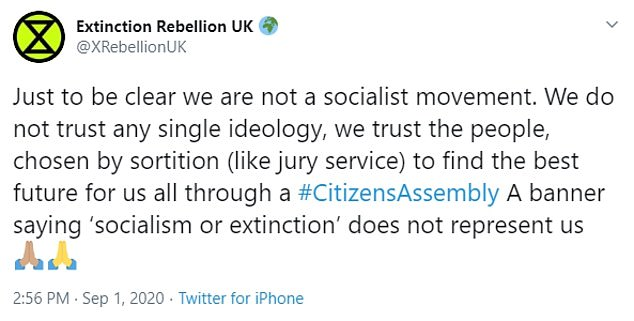 Hallam is also heard arguing for 'mass socialistic organisation', despite Extinction Rebellion tweeting on Tuesday that it is 'not a socialist movement'
