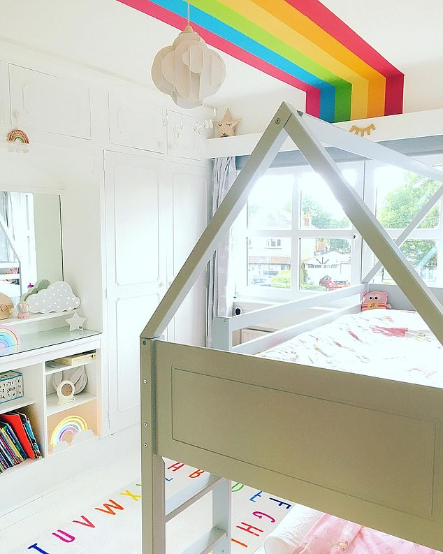 A magical multi-coloured transformation has taken place in another of the children's bedrooms, with a feature rainbow painted over the ceiling