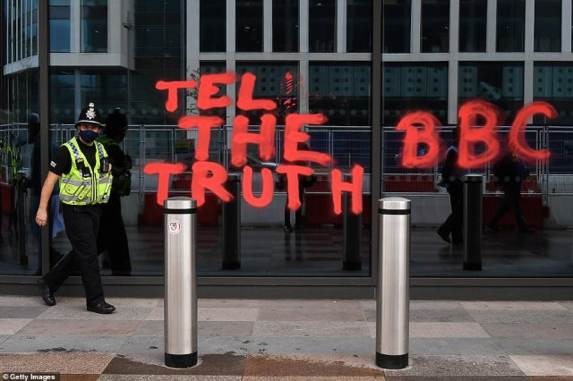 The demonstrators graffiti is pictured on the new BBC building in Cardiff as it was defaced during the protests this afternoon