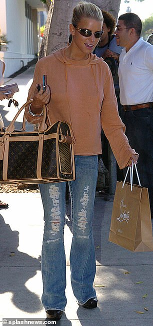 Day: Simpson shops for shoes at the upscale French designer Christian Louboutin shop on Burton Way in Beverly Hills her dog in 2004