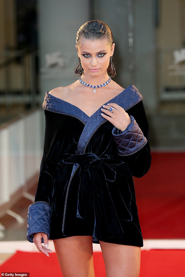 Glitzy:The American star added glitz to her look with a stunning blue and silver encrusted necklace, teamed with a huge statement ring