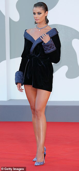 Sensational: Taylor's eye-catching dress featured quilted detailing and was cinched around her svelte waist with a knotted belt, highlighting her sizzling frame