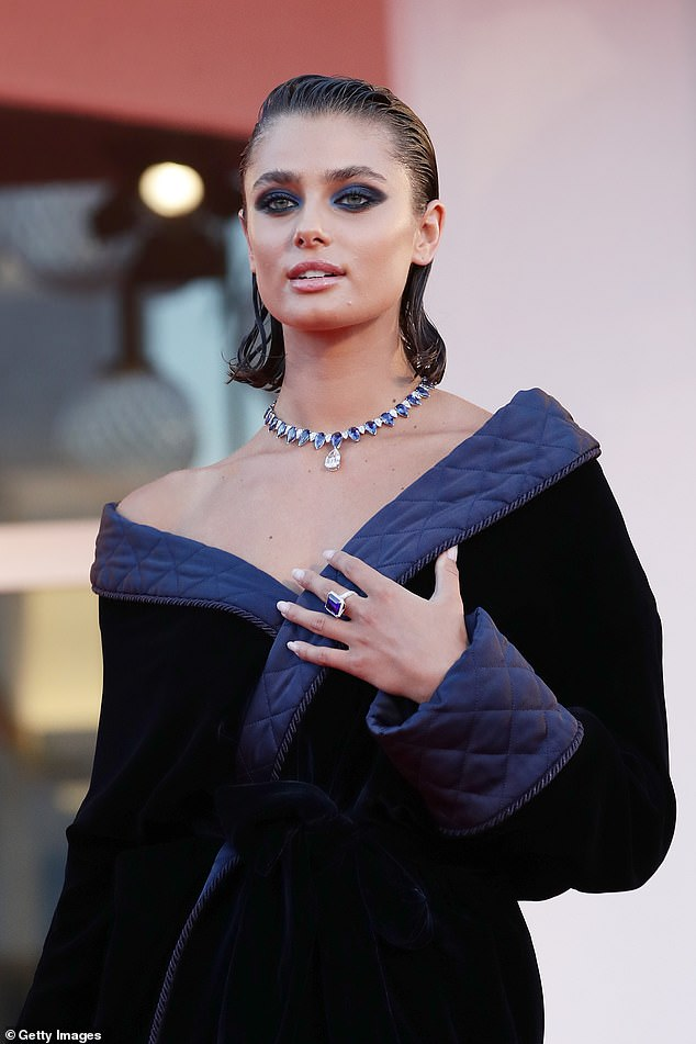 Wow:The Victoria's Secret model, 24, showcased her toned pins in a thigh-grazing velvet wrap dress, which flaunted her endless legs as she arrived at the festival