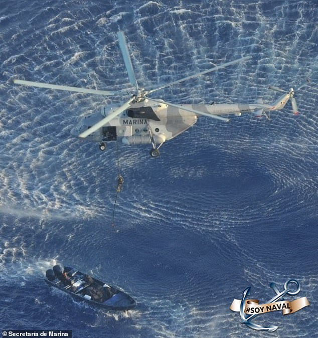 A Mexican soldier is lowered from a helicopter after a drug vessel was spotted off the Caribbean coast village of Mahahual on Tuesday. The military said 2,960 kilos of cocaine, valued at $142 million, were recovered from the speedboat