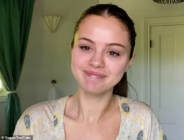 In her mansion:She is first seen makeup free with only long eyelashes in place as she talks while in the bathroom of her Los Angeles home